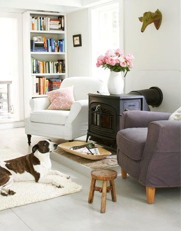 Winnie lounges on an area rug in this living room. Muddy pawprints won't phase you with machine-washable slipcovers and easy-to-mop wood floors.     #decorating