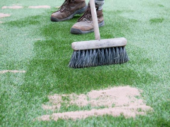laying artificial grass