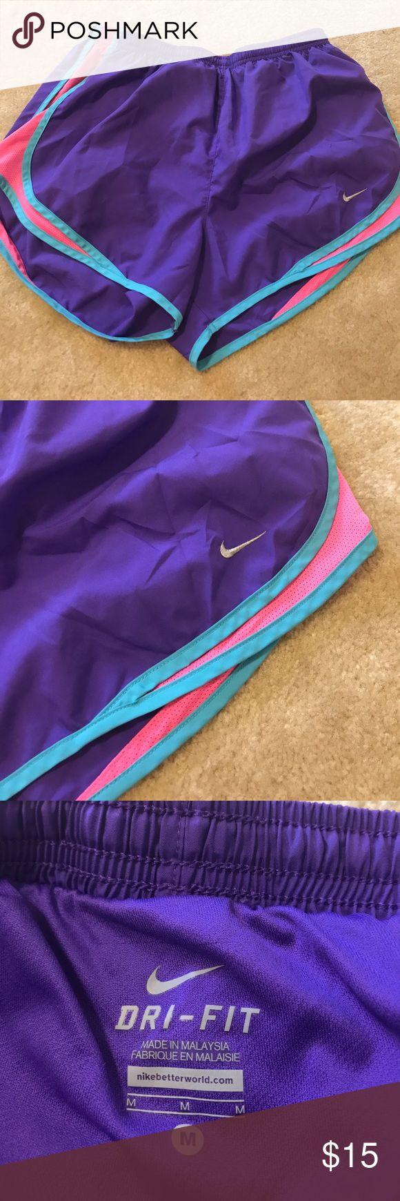 Women's Nike dri fit shorts sz M Women's Nike Dri-Fit shorts. Pink, purple and teal.  Has panty inside.  Size medium. Smoke free home. Like new Nike Shorts