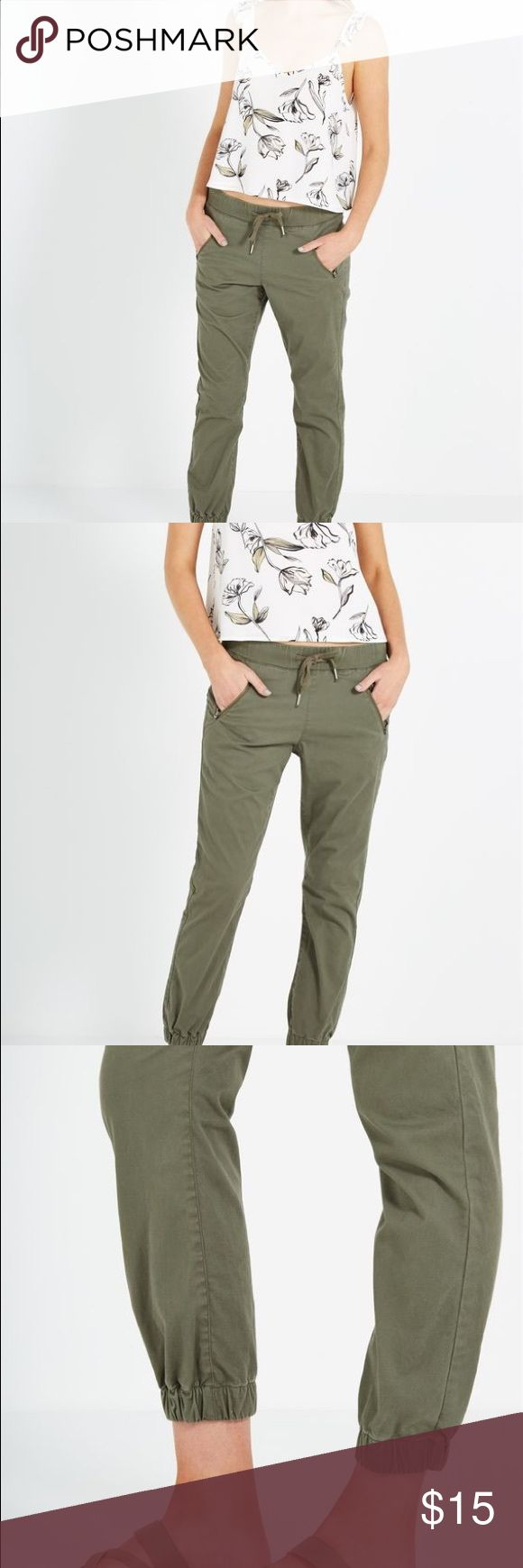 Olive Chino Joggers Cuffed chino jogger pants. Good condition. Last picture shows actual item and color. Color is darker than the first 3 pictures. Pants Track Pants & Joggers
