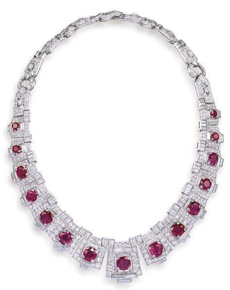 An important art deco ruby and diamond necklace, by Cartier, circa 1925 The Egyptian revival necklace designed as a series of fifteen cushion-shaped rubies graduating in size to the center, each within a geometric surround of brilliant and baguette-cut diamonds forming a tapering plaque, the backchain of shield and circular linking pavé-set with similarly cut diamonds, the largest to the center, diamonds approximately 30.00 carats total, signed Cartier