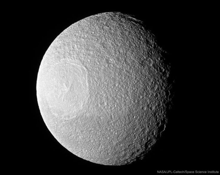 Astronomy Picture of the Day Sunday Odysseus Crater on Tethys  Explanation:  Some moons wouldn't survive the collision. Tethys, one of Saturn's larger moons at about 1000 kilometers in diameter, survived the collision, but today exhibits the resulting expansive impact crater Odysseus. Sometimes called the Great Basin, Odysseus occurs on the leading hemisphere of Tethys and shows its great age by the relative amount of smaller craters that occur inside its towering walls. The density of…