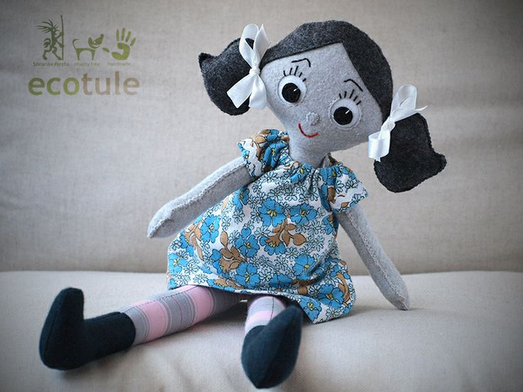This doll is 100% hand made and it's made from felt.  It's nice and soft, perfect for hugging.  I made dress separately from old, recycled material.