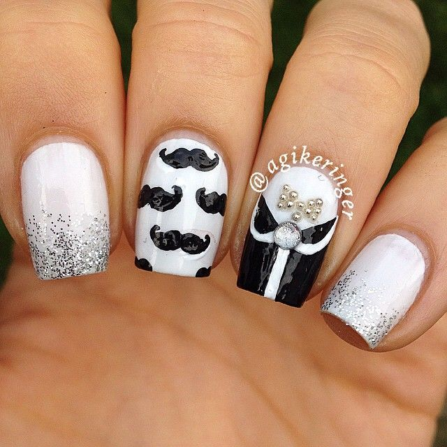 Snazzy Movember mustache nails in black and white by @agikeringer