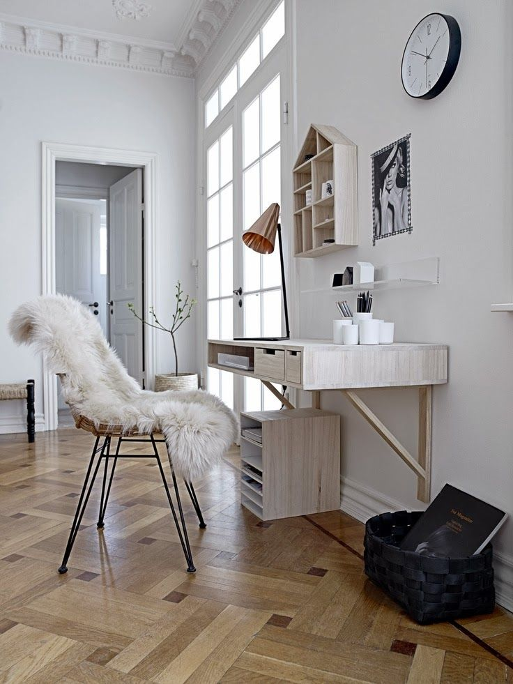 All white room with giant ceilings and peaceful work station.