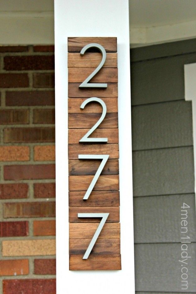 Cut wooden paint stirrers to size and stain them to make a midcentury modern backdrop for house numbers.