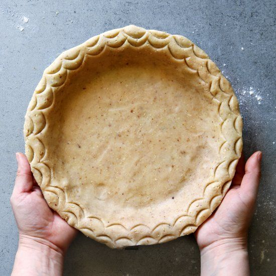 This buttery, flaky,melt in your mouth pie crust is made with walnuts and the recipe has 2 more secret ingredients....