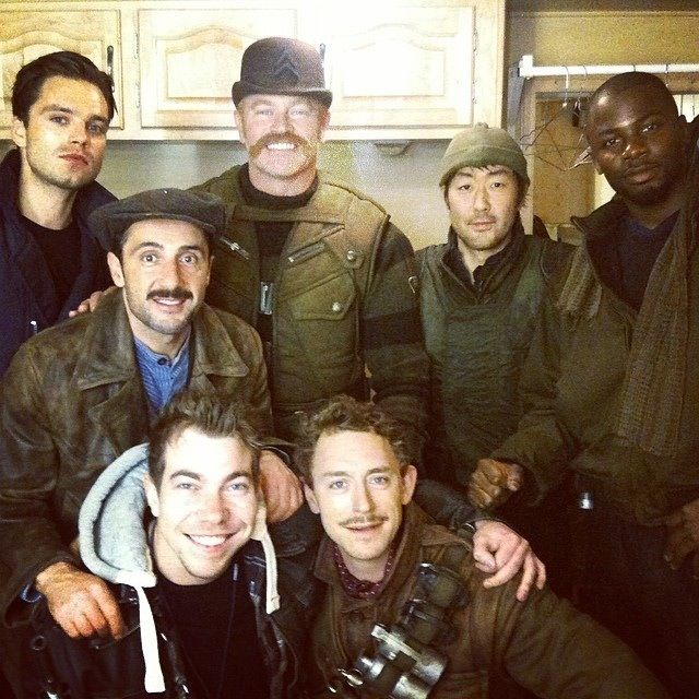 Bucky and the Howling Commandos! <<< I love how they're all smiling and together in the picture and wearing the outfits and Bucky's just over there like yo I'm hiding
