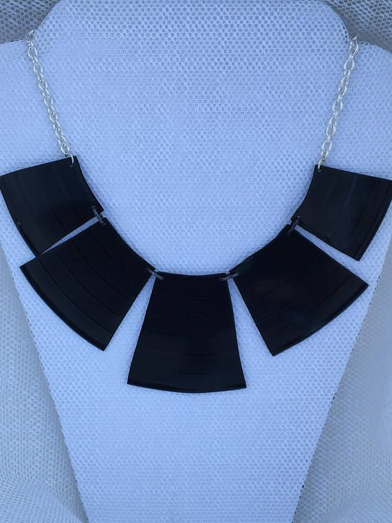 Re-purposed vinyl record album necklace with silver chain