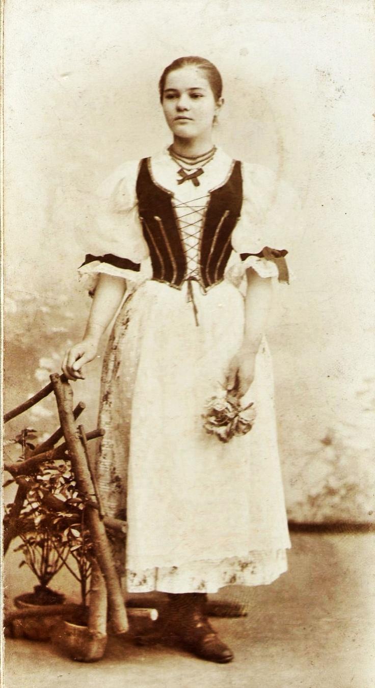 Magyar girl in traditional folk dress, 1900