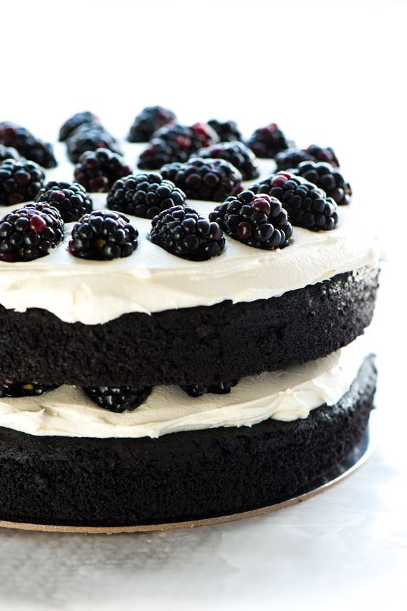 black velvet cake with blackberry and cream cheese filling frosted with vanilla bean bakery buttercream | Sweetapolita