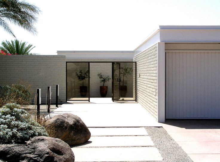 "PALM SPRINGS ARCHITECTURE: Max Palevsky Residence, Designed by Craig Ellwood, 1969 ... ""The house was based on desert houses in Casablanca that were white-walled compounds with structures set within rectangular walls, and it is beautifully integrated into its boulder-strewn site. Its minimalist aesthetic makes it one of the town's most enigmatic structures."""