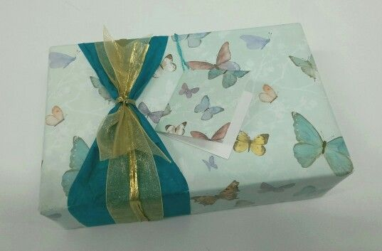 'Butterfly Bows';  Butterfly Sky Gift Wrap (Sold Out), Teal Tissue (TS22), Gift Tag (Sold Out), Gold Organza Ribbon (RS25), Gold Raffia Ribbon (RS48).    Cost of materials used to wrap this gift is AU$2.50 based upon portion used of packaged volume.     https://www.phoenix-trading.com.au/web/thecardlady