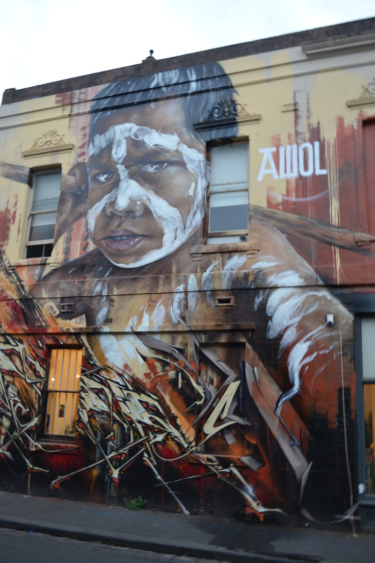 Street art on the corner of Fitzroy street and Johnston street Fitzroy this is new art piece there was a truly amazing art piece there but a tagger destroyed and this replayed it