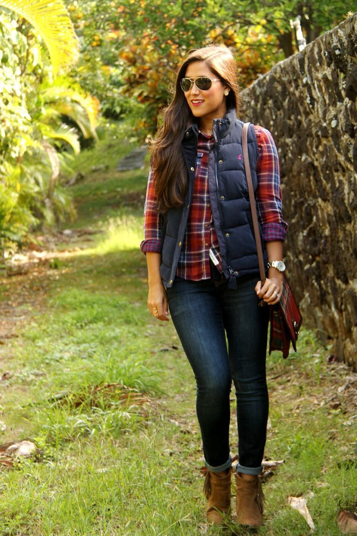 A deep blue quilted vest and navy skinny jeans are a great outfit formula to have in your arsenal. Elevate your getup with brown suede ankle boots.  Shop this look for $273:  http://lookastic.com/women/looks/sunglasses-vest-watch-crossbody-bag-ankle-boots-dress-shirt-skinny-jeans/7585  — Black Sunglasses  — Navy Quilted Vest  — Silver Watch  — Red Plaid Leather Crossbody Bag  — Brown Suede Ankle Boots  — Red Plaid Dress Shirt  — Navy Skinny Jeans