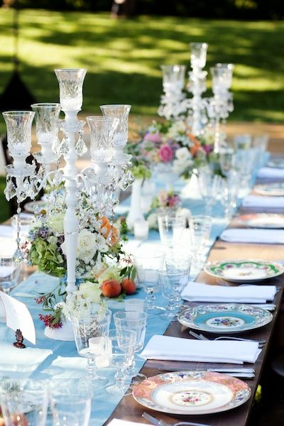 Beautiful table setting; love the different patterns of china and use of stemware.