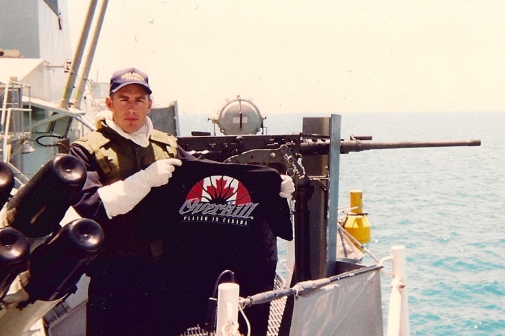 "Lieutenant Christian Hatch proudly shows off his Overkill shirt on Her Majesty's Canadian Ship ""Regina""... July 1997... Enforcing UN sanctions against Iraq"