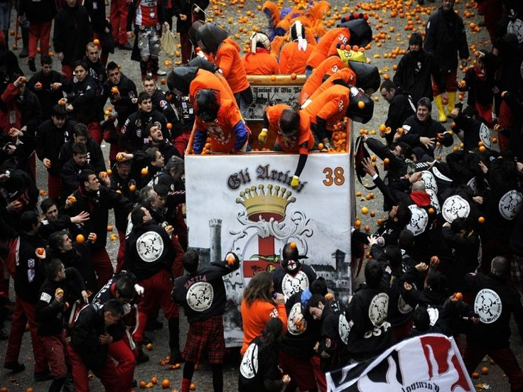 """Battle of the Oranges The Battle of the Oranges is a festival held in the Italian city of Ivrea. """"Teams"""" beam each other with oranges in the largest food fight in Italy. Spectators are urged to wear red hats, unless they're really craving high-velocity oranges to the teeth."""