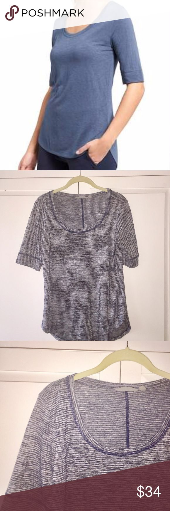 Athleta Breezy T Navy/White Stripe M Soft, breathable and easy care, this jersey tee has the perfect texture and drape Curved hem is longer in back for extra coverage Scoop neck front, center back seam lends a slimming effect BREATHABLE. Sweat can travel through the fabric so it can evaporate on the surface EASY CARE. Just throw in the wash and dry without a second thought IT FEELS: Lightweight, super soft, textured like linen, live-in comfortable Machine wash and dry. Navy Stripe. Athleta…