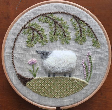 Sheep crewel embroidery.