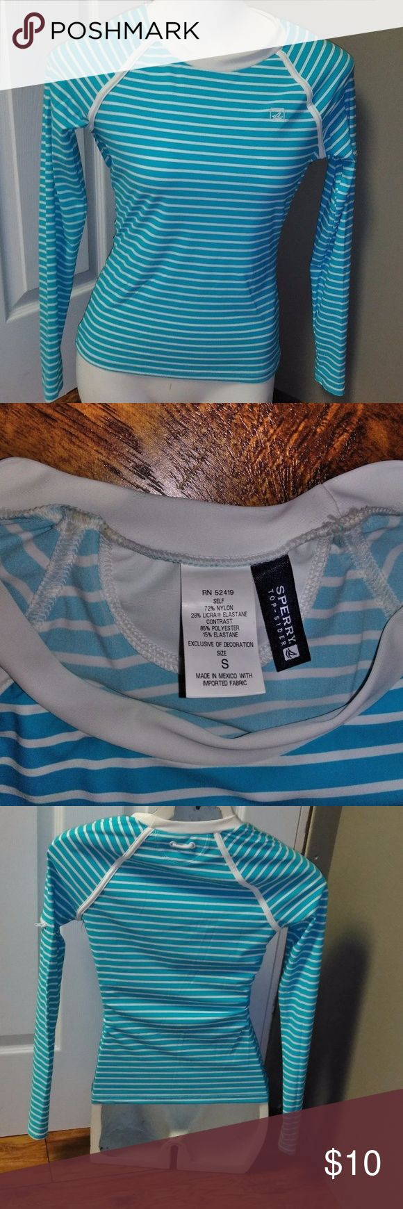 SPERRY TOP SIDER Striped L/S Active Top ~~ Small Up for sale is for a long sleeve misses active top by SPERRY TOP SIDER ~~ Size Small  This top is mainly light blue in color with thin white stripes. Has a zipper pocket on the left sleeve. Fitted top that is very lightweight.   Made of 72% Nylon, 28% Elastane  Excellent condition with no flaws or stains and comes from my clean smoke free and pet free home. OFFERS WELCOME! Sperry Top-Sider Tops
