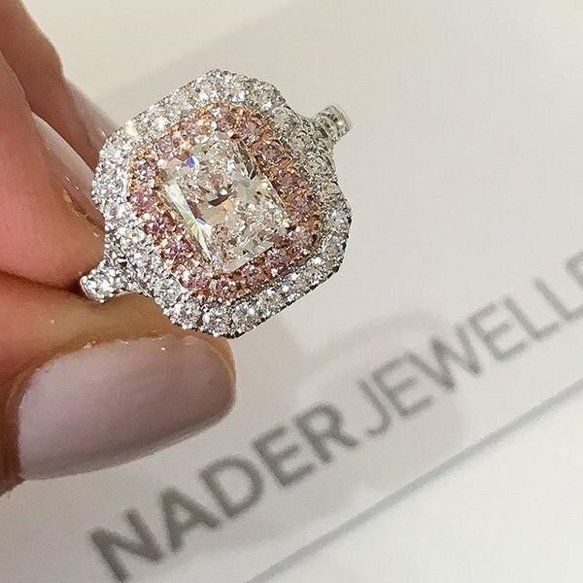 Diamond ring by Nader Jewellers with pink diamond accents.