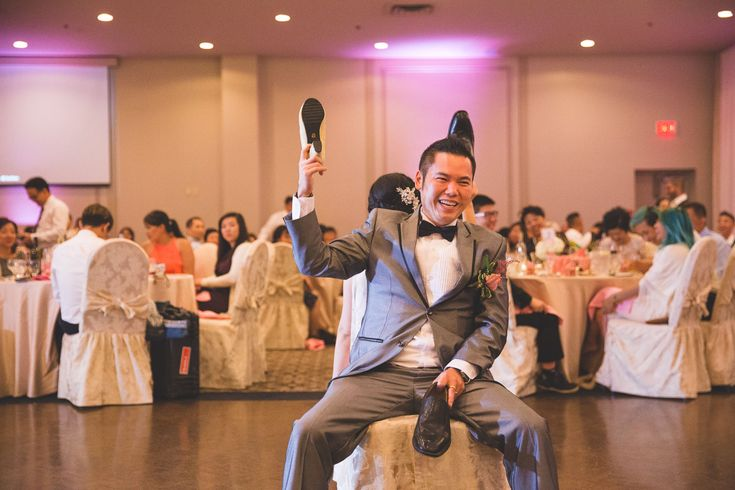 Wedding Photography / Toronto photographer / Reception Shoe Game / www.wilsonhophotography.com