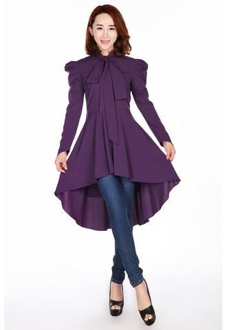 Flared dress with roll collar, double buttons down the top front, with a belt and buttons on the cuffs. Sleeves can be turned. One large ruffle on the skirt. Pe