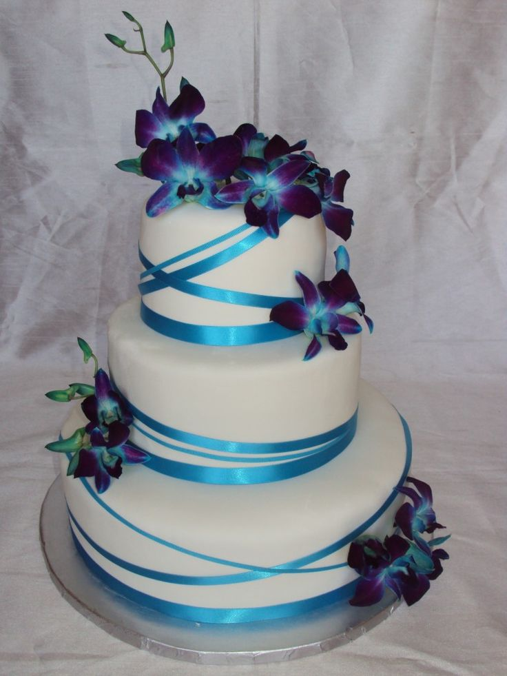 Jenna's Orchids- Blue dendrobium orchids atop a fondant covered cake wrapped with teal ribbons of varying widths.