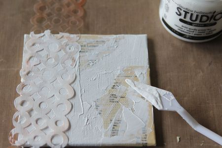 template used, gesso used, strips of text from a book, ink sprays. Good mixed media tutorial/project