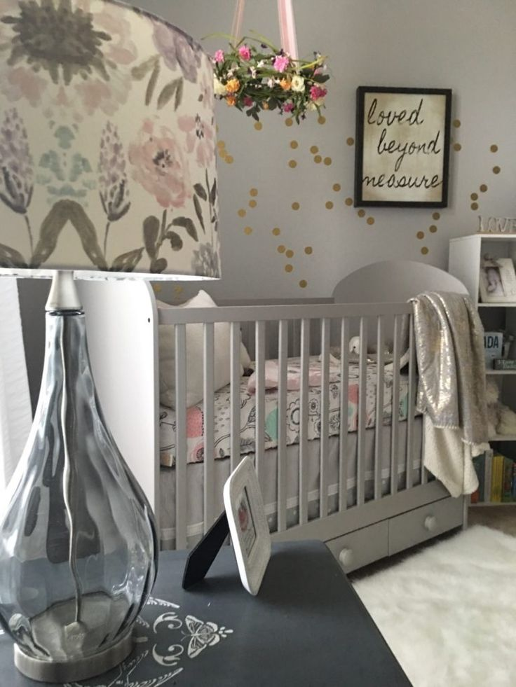 Project Nursery - This gray crib from IKEA was the perfect color for the look Kelsey & Matt wanted in their baby's nursery.  The floral lamp is from Home Goods.