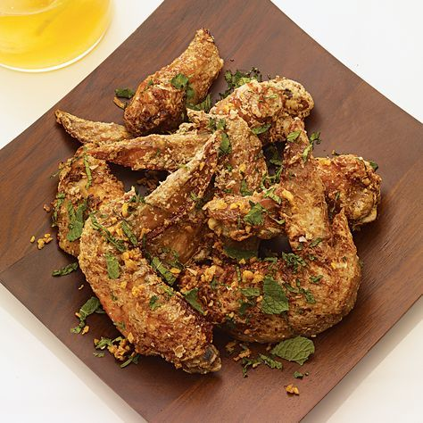 Ike's Vietnamese Fish Sauce Wings. Chef-owner Andy Ricker, who takes annual trips to Southeast Asia, first tried fish sauce wings at a roadside stand in Saigon seven years ago. He scribbled down his guess at the ingredients on a paper napkin, which he carried with him until Pok Pok opened. | Food & Wine