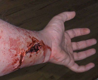 Fantastic low-budget fake wound tutorial for Halloween. Can use corn syrup and red food coloring instead of buying stage blood.