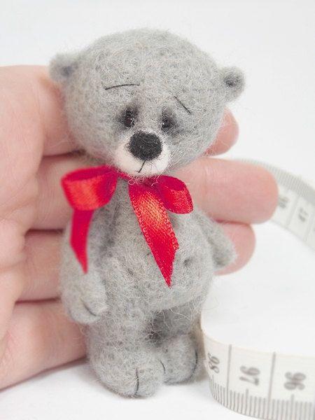 8 cm height. Teedy bear has got moveable feet and head.