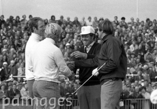 Scotland's Brian Barnes, right, and England's Peter Butler, wearing cap, members of Team Great Britain and Ireland, shake hands with Tom Weiskopf, left, and Jack Nicklaus of the United States team, after the Americans had one their Foursomes match in the Ryder Cup, at Muirfield, Scotland, on Sept. 21, 1973. (AP Photo)