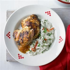 Jerk chicken thighs with coconut rice Recipe | delicious. Magazine ...