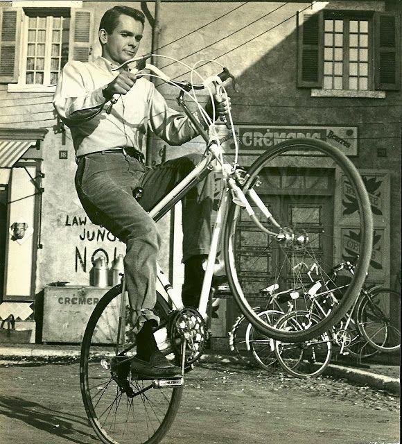 Dean Jones wheelies a bike, 1967