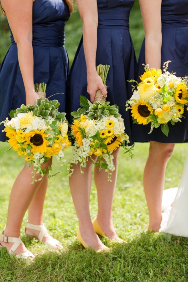 Black bridesmaids dresses instead of navy + sunflower bouquets. Re-pin if you like. Via Inweddingdress.com