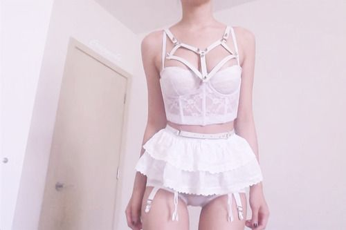 White gothic harness lingerie. Pastel goth style