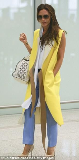 Victoria Beckham looks so chic and posh wearing blue trousers, aviator style sunglasses, a yellow coat and white shirt from the new AW13-14 Collection <3<3 Absolutely love her cream color Manolo Blahnik pumps ;)