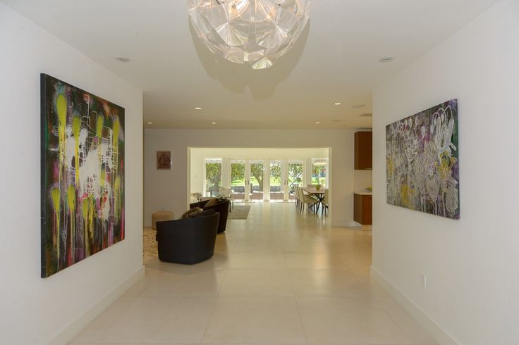 Contemporary Hallway with limestone tile floors, Chandelier