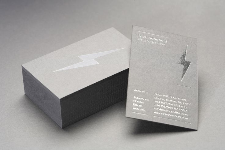 Business cards with a grey board a silver foil print finish for Rick Schofield designed by Very Own Studio.