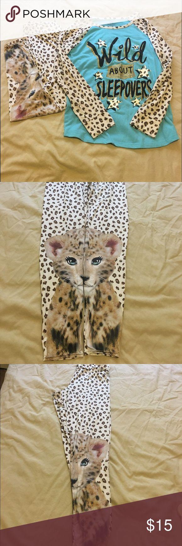"Girl's Justice Cheetah Print Pajama Set Blue shirt w/ cheetah print sleeves. Cheetah Print joggers cheetah graphic on lower legs. Polyester ""Wild About Sleepovers"" stars on shirt Long sleeve glitter Justice Pajamas Pajama Sets"
