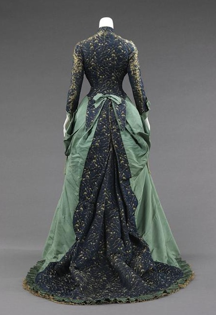 Worth Dress, Evening. 1875 narrow fitted sleeves, open robe and petticoat effect, tied back bow manipulation bustle, ruffle decoration  Bustle period 1870-1878