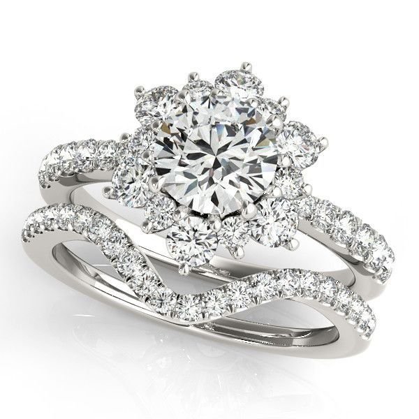 A beautiful and perfectly matching diamond wedding set. The center stone is a gorgeous Forever Brilliant moissanite.