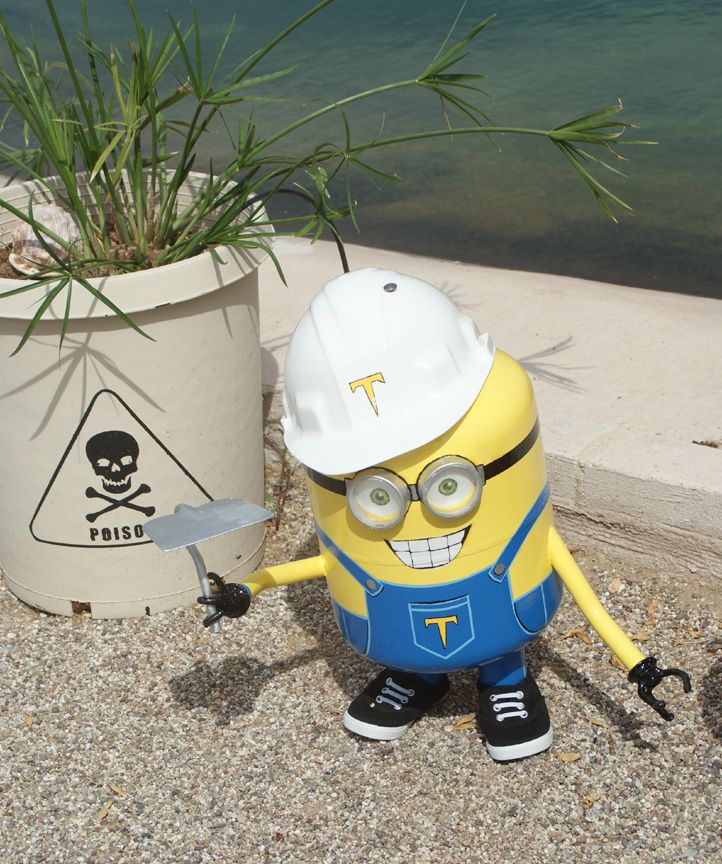 Garden minion: made with Freon tank, muffler pipe, & water pipe. The lens are plexiglass from a display cabinet sliding door.
