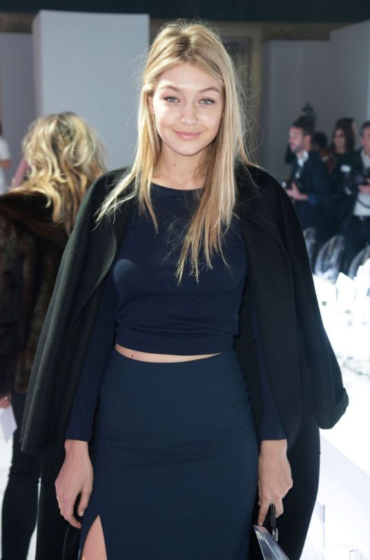 Gigi Hadid // fresh face, black coat, navy crop top & high-waisted skirt…