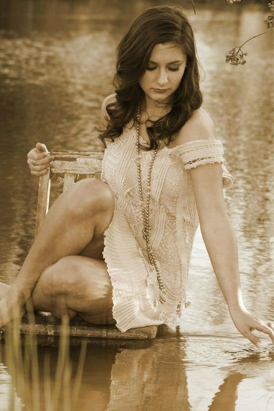 cute senior picture ideas | Flirty Senior Picture Sitting above the Water