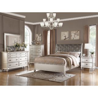 Sleep in sophistication with this Saveria 5 piece bedroom set. The silver finish, classically designed bed frame, upholstered headboard, bulb-like leg supports and additional furniture create a sense