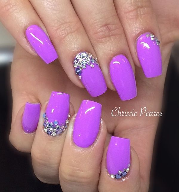 Another beautiful Purple nail art design with embellishments. Creatively place the embellishments on the cuticle of the nails so that they create a semi frame effect on the matte polish below.